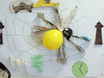 Team bastelt seine Arbeit sinnbildlich Spinne im Netz